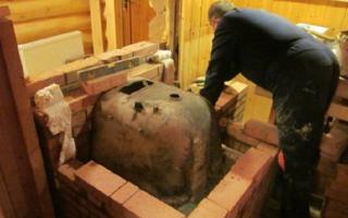 Печь из чугунной ванны своими руками: фото, видео